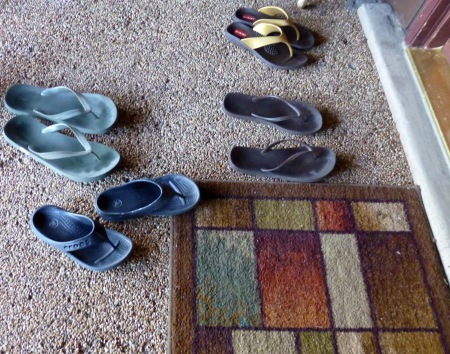 shoes-left-outside-front-door-of-siddhayatan-retreat-center